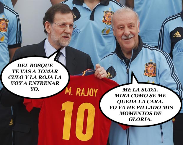 Spain's PM Rajoy holds a Spanish national soccer shirt with his name during his visit to the Soccer City area in Las Rozas